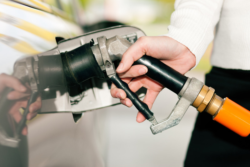 Woman refueling car with LPG gas